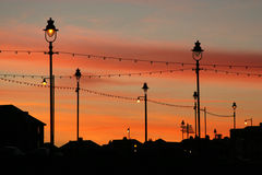 przeciw budynków świateł czerwonemu nieba zmierzchowi Fotografia Royalty Free