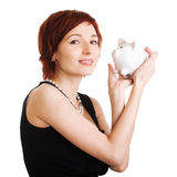 przeciw tła banka mienia prosiątka białej kobiecie Fotografia Stock