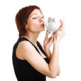 przeciw tła banka mienia prosiątka białej kobiecie Obraz Stock