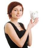 przeciw tła banka mienia prosiątka białej kobiecie Obrazy Royalty Free