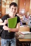 Przed klasą uśmiechnięta chłopiec Zdjęcie Royalty Free