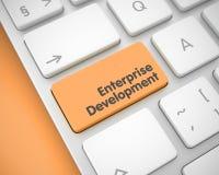 Przedsięwzięcie rozwój - tekst na Pomarańczowej Klawiaturowej klawiaturze 3d zdjęcia royalty free