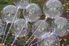 Przejrzyści balony z kolorów światłami wśrodku obraz stock
