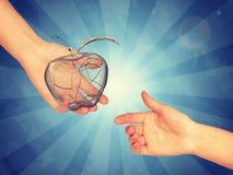 Przejrzysty jabłko w ręce Obraz Stock
