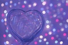 Przejrzysty serce nad zamazanym bokeh skutka tłem Obrazy Stock