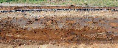 Przekrój poprzeczny bruk z warstwami gliniany piasek i aspha zdjęcia royalty free