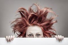 Przelękła kobieta z upaćkanym włosy Obraz Royalty Free