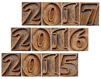 Przelotni i przybywający rok w drewnianym typ Fotografia Royalty Free