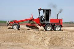 Przemysłowa maszyna buduje nową autostradę Obraz Royalty Free