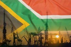 Przemysłowy pojęcie z Południowa Afryka flaga przy zmierzchem Zdjęcia Royalty Free