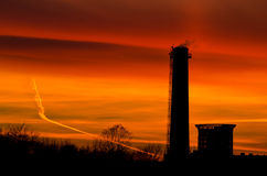 Przemysłowych budynków sylwetki przy zmierzchem Obraz Royalty Free