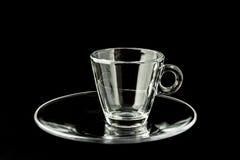 Przerzedże pustą szklaną filiżankę na czarnym tle Fotografia Royalty Free
