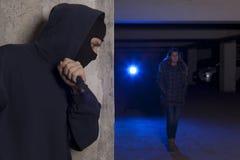 Przestępca z nożowym czekaniem dla kobiety Fotografia Royalty Free