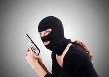 Przestępca z pistoletem odizolowywającym na bielu Fotografia Stock