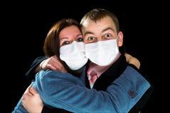 przestraszona opatrunków mężczyzna maski kobieta Obrazy Royalty Free