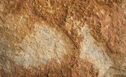 Przetarta pomarańczowej czerwieni betonu kamiennej ściany tekstura Zdjęcia Stock