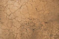 Przetarta pomarańczowej czerwieni betonu kamiennej ściany tekstura Obrazy Stock