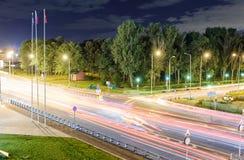 Przewieziona metropolia, ruch drogowy i rozmyci światła, Zdjęcie Stock