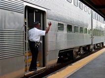 przewodnik dojeżdżającego pociąg Obrazy Royalty Free