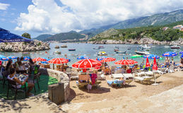 PRZNO, BUDVA RIVIERA AREA, MONTENEGRO, AUGUST 2, 2014: Panoramic view of the bay and city beach with many people in small lagoon i. N Przno city royalty free stock photo