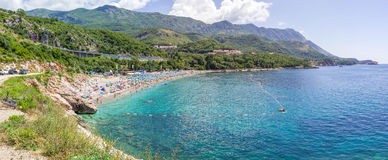 PRZNO, BUDVA RIVIERA AREA, MONTENEGRO, AUGUST 2, 2014: Panoramic view of the largest beach with many people in lagoon in Przno cit Stock Images