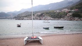 Przno, Montenegro. Beach, sun beds and umbrellas on the beach, t stock video footage