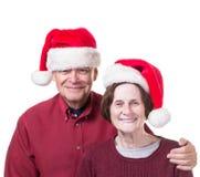 Przy Bożymi Narodzeniami szczęśliwa starsza para Fotografia Stock