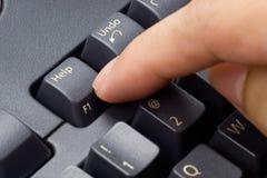 przycisk pomocy tłoczenie palców Fotografia Royalty Free