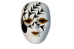 przygląda się złotą odosobnioną maskę Zdjęcie Royalty Free