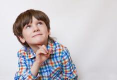 Przyglądająca up wymarzona chłopiec Zdjęcie Stock