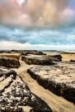 Przyglądający morze od Kamiennego Jetty Out Obrazy Royalty Free