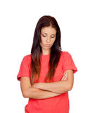 Przygnębiona brunetki dziewczyna ubierająca w czerwieni Zdjęcia Stock