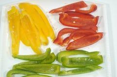 Przygotowanie w kuchni trzy pieprzu dla kolorowego naczynia Obraz Stock