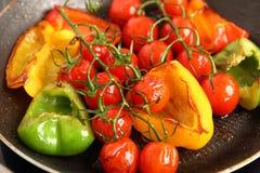 Przygotowywa pomidory i paprykę Obrazy Royalty Free