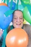 Przyjęcia urodzinowego starszy świętowanie obraz royalty free