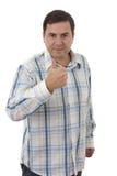 Przypadkowego młodego człowieka iść kciuk up, odizolowywający Obrazy Royalty Free