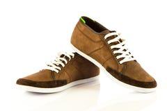 Przypadkowego stylu sporta buty odizolowywający na białych tło akcesoriach Zdjęcie Stock
