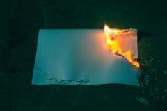 Przypalał papierowego prześcieradło na zmroku Fotografia Royalty Free