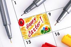 Przypomnienie Szczęśliwa wielkanoc w kalendarzu z coloured piórami Zdjęcie Stock