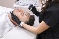 Przyrząd jest twarzowym kosmetologią zdjęcia royalty free