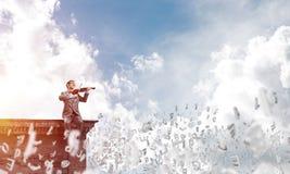 Przystojna biznesmen sztuka jego symbole i melodia lata wokoło w powietrzu zdjęcia royalty free