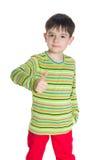Przystojna chłopiec z jego kciukiem up Obraz Stock