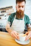 Przystojna mężczyzna narządzania kawa Zdjęcie Royalty Free