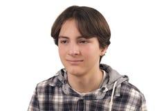 Przystojna nastoletnia chłopiec patrzeje daleko od Zdjęcia Stock