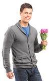 Przystojni młodego człowieka mienia tulipany Obraz Stock