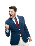Przystojny biznesmen świętuje jego sukces Zdjęcia Stock