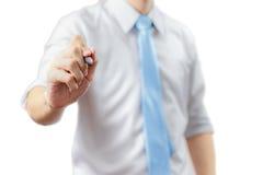 Przystojny Biznesowego mężczyzna writing z piórem w powietrzu odizolowywającym obraz stock
