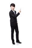 Przystojny Biznesowy mężczyzna przedstawia ręką fotografia royalty free