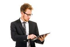 Przystojny biznesowy mężczyzna z pastylka komputerem Zdjęcia Stock
