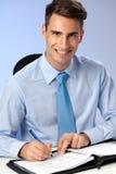 Przystojny biznesowy writing na papierach Zdjęcie Stock